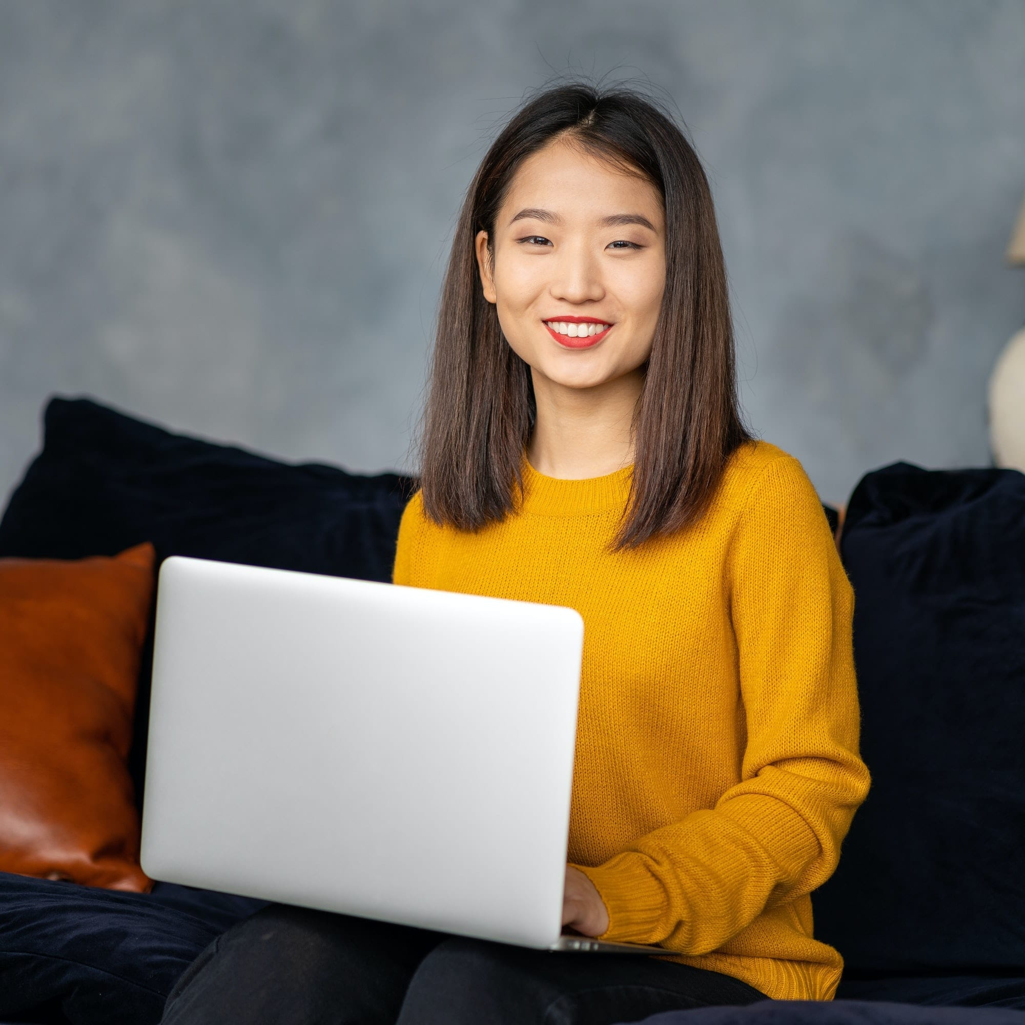 Asian business woman working in laptop on sofa. Japanese businesswoman work at home