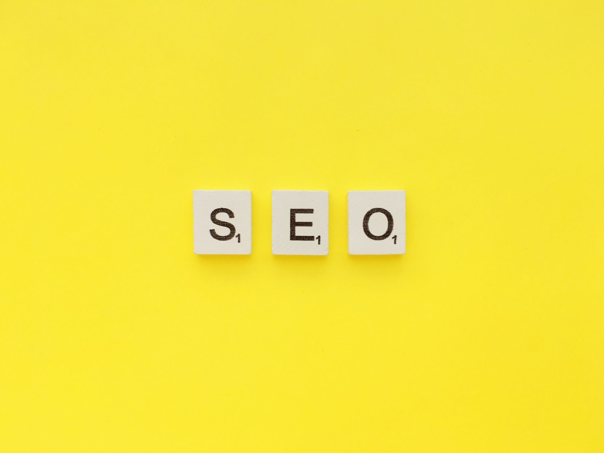 SEO scrabble letters word on a yellow background