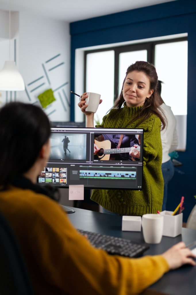 Women videographers editing video project creating content